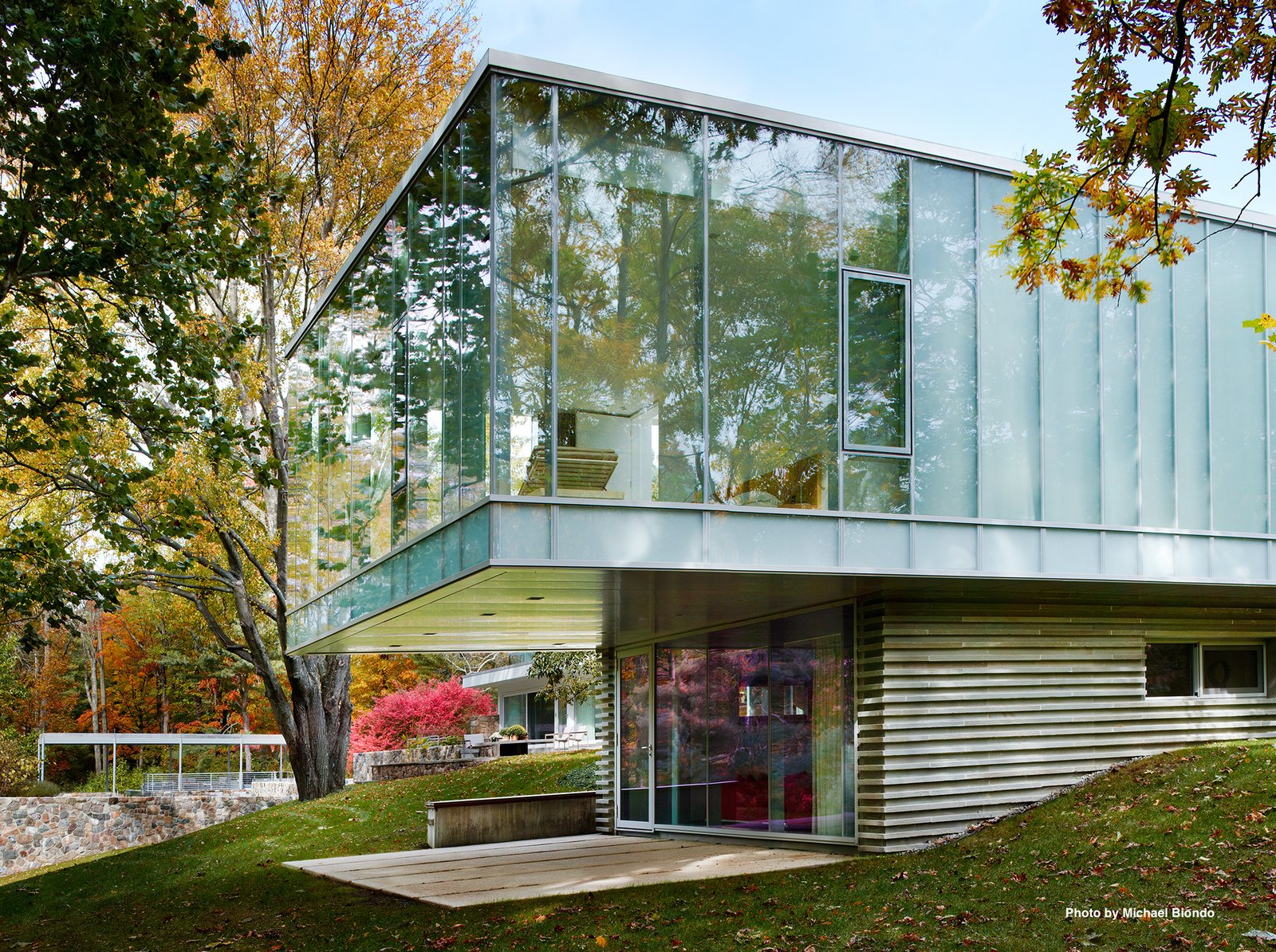 """Mori's addition is constructed of steel, concrete, and glass with a Bluestone veneer. Mori decided to preserve the ceiling height of the main house to be 11'6"""". The roof is lined with Volcaic solar panels.  Photo 7 of 9 in Marcel Breuer's Revived Home Could be Yours for Just Under $5 Million"""