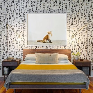 The husband-and-wife team behind Rethink Design Studio sent us this bedroom shot from a home they designed for a family of four. They covered the bedroom wall with a bold patterned wallpaper from Hygge & West and finished it with artwork from the Animal Print Shop.