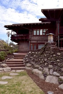 Inspired by Japanese architecture, the Greenes ensured that there were no hard edges to be found on the property. Everything is round and smoothed out, including the bricks in the yard. The exterior of the house is lined with Douglas fir and the extended overhanging eaves act as cooling agents while protecting the porch from the rain.