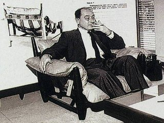 George Nelson is shown here in 1965 sitting in a Sergio Rodrigues armchair in Rio.