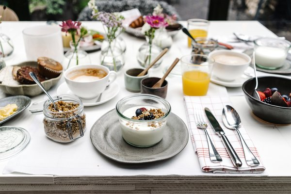 A complimentary breakfast is served each day, which includes fresh yogurt, house-made granola, pastries, avocado toast, and cheese.