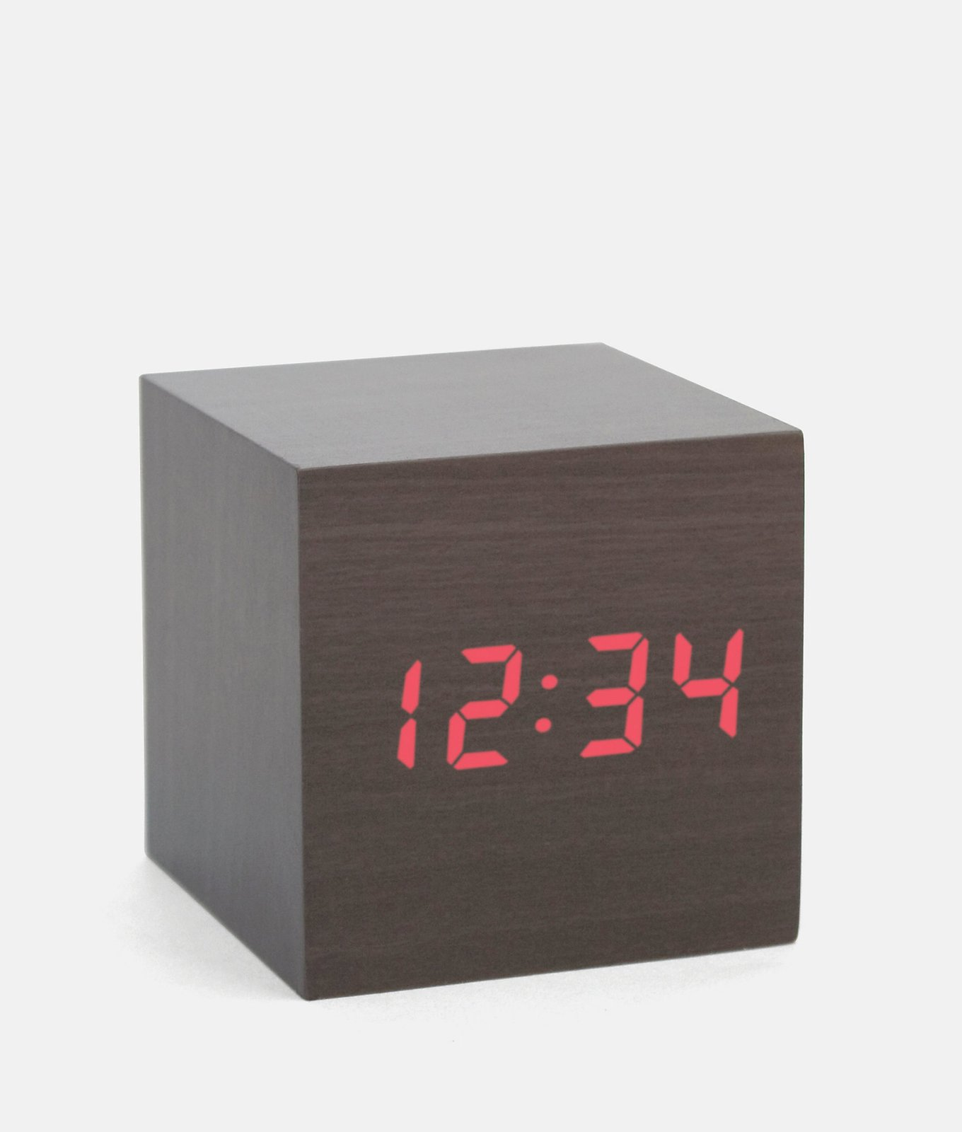 A minimalist LED clock activated by the clap of your hands. Jack Spade Cube Alarm Clock, $30  Photo 3 of 12 in Stocking Stuffers That Will Please the Modernists in Your Life