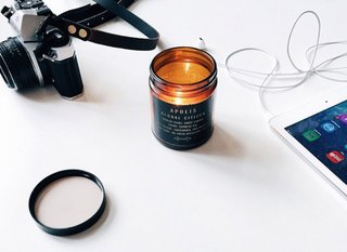 The portable design is perfect for bringing light (and a subtle cypress fig perfume) anywhere. Apolis Transit Issue Table Candle, $24