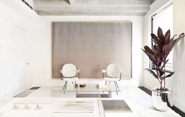 Shown here is the lounge/waiting area where customers can make themselves at home when they first enter. Early Work's co-founder and artist Mimi Jung created the woven artwork that hovers over the space.