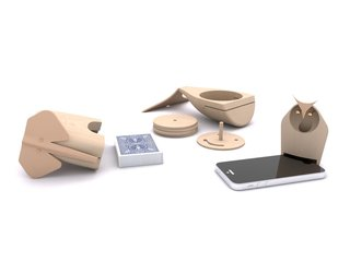 After making the sketches, they moved to creating 3D models on the computer. In these renderings, you can see how they were able to capture the personality of each figure. The elephant acts as a card holder (for a custom set of cards that's included), the whale is a wooden coaster set of four, and the owl is a sound amplifier.