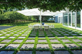 A Thomas Phifer-Designed Glass-and-Steel Masterpiece For Sale - Photo 14 of 14 - Dan Kiley filled the entire property with thoughtful landscape elements, including this patched concrete outdoor dining area.