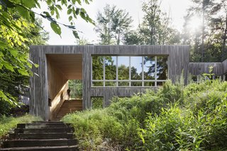 A Cypress-Clad Lake House Posted Up on an Old Logging Road