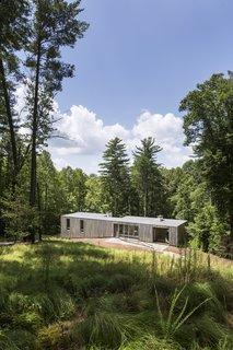 "The simple bar-shaped house is buried into the hillside, which allows for unobstructed views of the woods below.<span> <a href=""/discover/dwelllpow"">#dwelllpow</a></span>"
