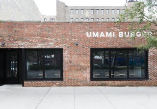 A Popular Burger Joint Flaunts Its Roots With the Help of a Design Collective - Photo 1 of 8 - As one of the new locations, the facade of the Chicago Umami Burger was left mostly untouched besides a simple, modern logo and dark black windows that help keep the mystery alive.