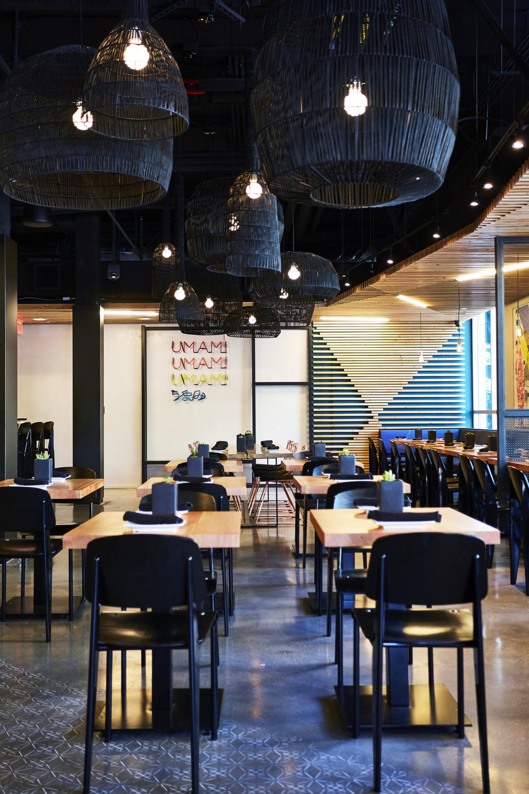 At the new Santa Monica location, they took cues from Ruth Asawa—the legendary Japanese-American sculptor—by scattering woven Nama pendant lanterns by Ay illuminate throughout.  Photo 4 of 9 in A Popular Burger Joint Flaunts Its Roots With the Help of a Design Collective