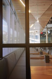 In order to help create a bit of privacy in certain areas of the Santa Monica locale, they created perforated metal screens that were are by traditional shoji screens.