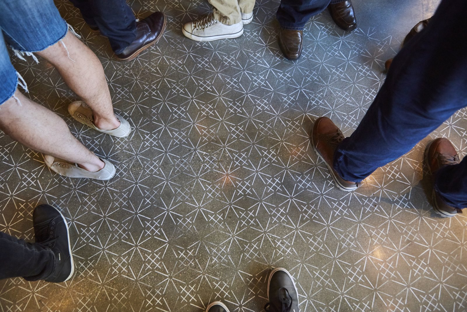 The stenciled floor takes cues from Sashiko embroidery textile designs.  Photo 9 of 9 in A Popular Burger Joint Flaunts Its Roots With the Help of a Design Collective