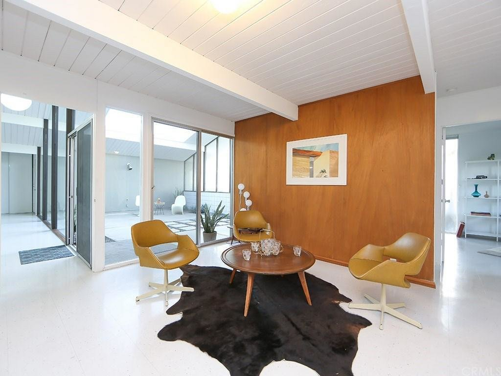 Though many aspects were kept original, it also includes some important updates including a brand  new foam roof. The different sections of the open floor plan can be turned into dining or lounge nooks.  Photo 5 of 8 in This Quintessential Eichler Will Hit All Your Midcentury Goals—and It's For Sale