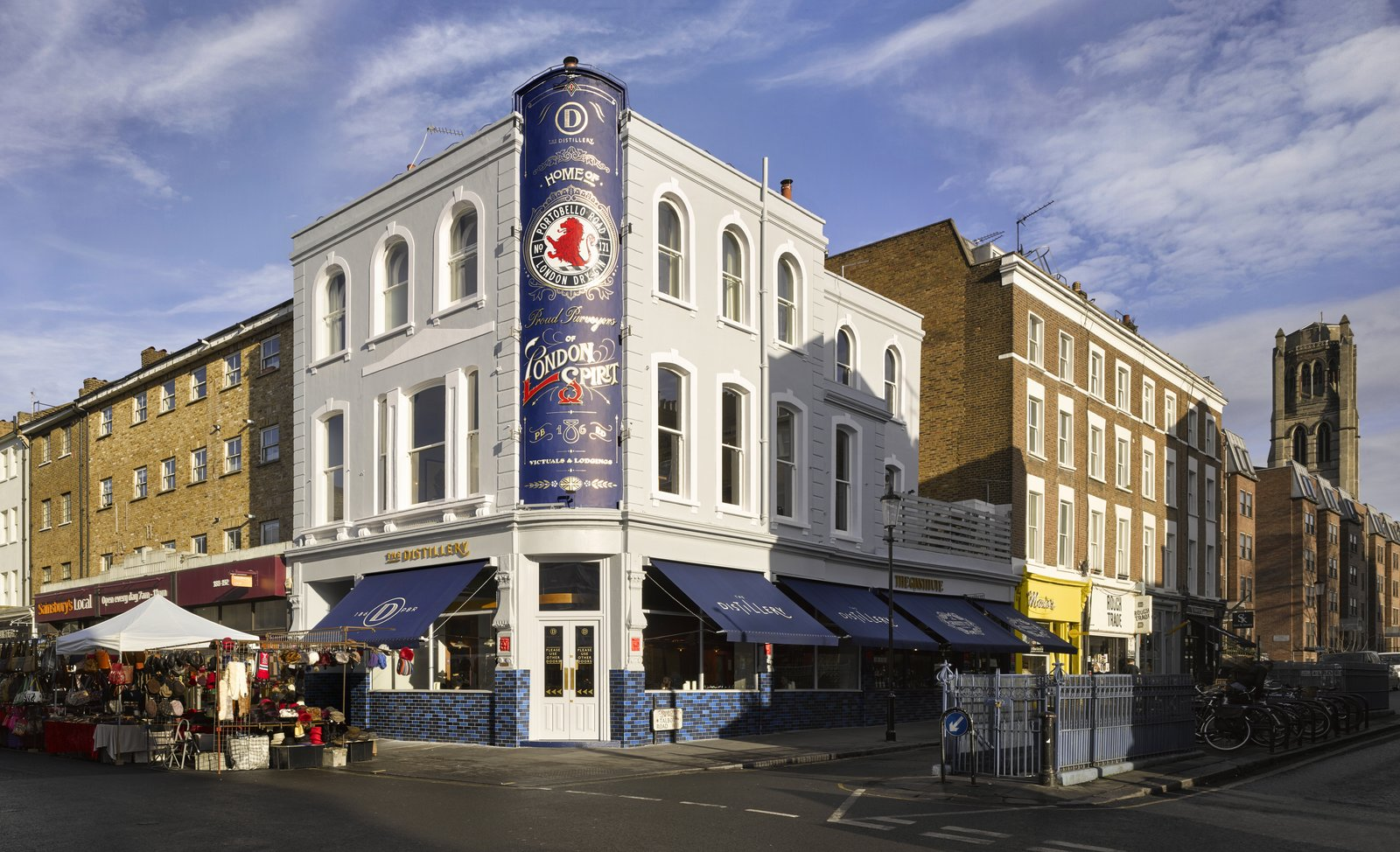 Exterior Located smack-dab in London's Notting Hill district, The Distillery sits on a bustling corner of the iconic market street and is marked by a classic, nostalgic facade.  Photo 1 of 7 in Gin Enthusiasts Will Be Flocking to This New London Hotel