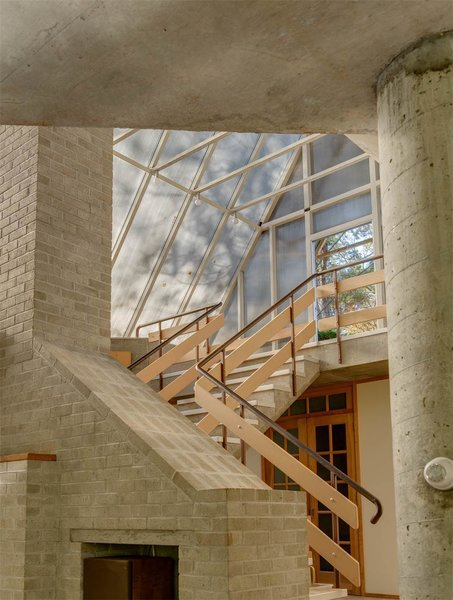Wood-and-metal stairs lead up from the living space to the skylight entrance. The glass A-frame gives the feeling of a greenhouse or garden shed.  Photo 7 of 11 in The One-of-a-Kind Home of the Late Architect John Black Lee Drops to $750K