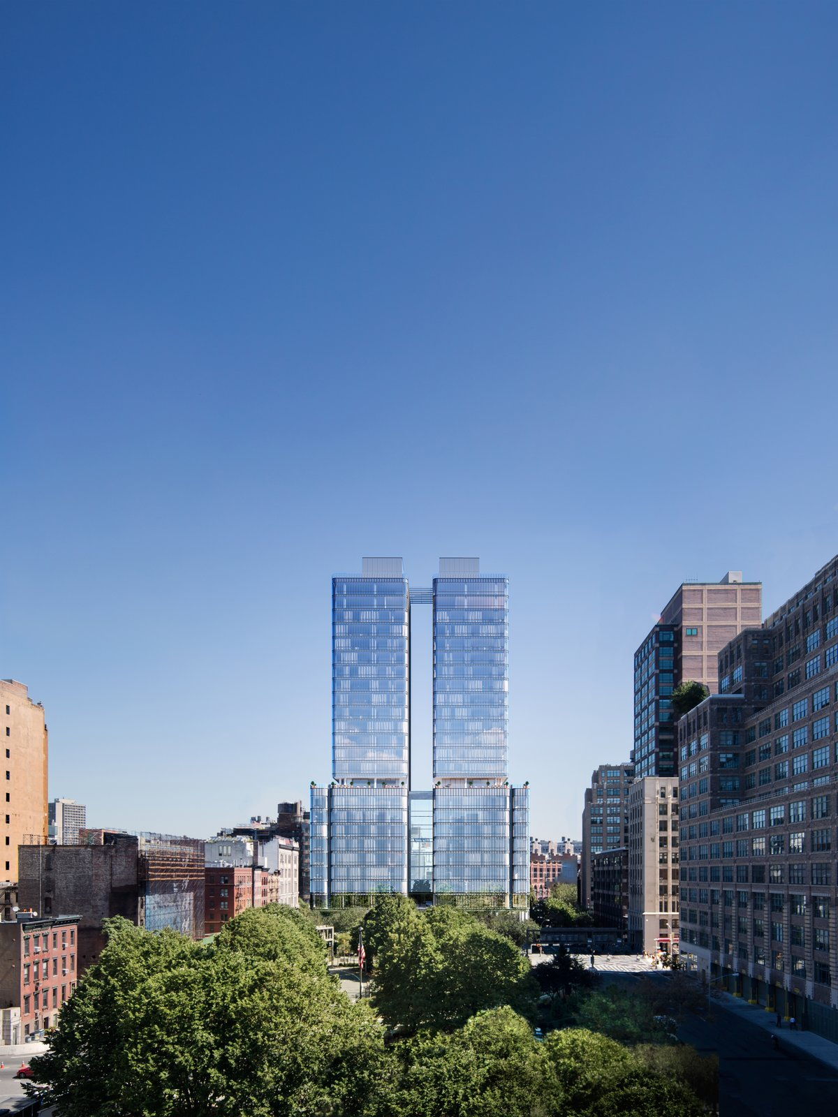 The double-tower, curved glass structure is located in an area of the city that will bridge the gap between the traditional Soho neighborhood and its west section. Its strategic orientation provides 360-degree views of the Hudson River, the World Trade Center, and much of Manhattan.  Photo 2 of 9 in Renzo Piano Building Workshop Brings a New Residential Destination to Soho