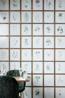 To evoke a connection to nature throughout the space, GamFratesi installed large botanical wall displays and plenty of greenery.