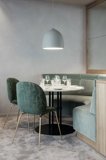 GUBI's Beetle Chairs are used throughout the space and are upholstered with various textiles that represent both Nordic and Art Deco influences.