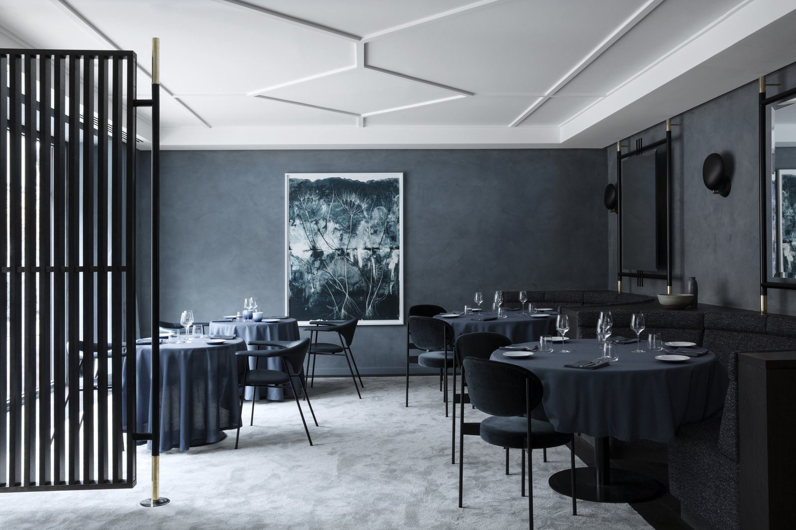 Unlike Flora Danica, Copenhague is draped in darker, more intense colors and textures. The walls are lined with GUBI's Cobra Lamps while the large-scale mirrors come from the same design concept as their TS Collection.  Photo 9 of 10 in The Revived Maison du Danemark Brings Two New Danish Restaurants to Paris