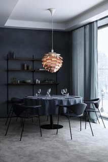 Also part of GUBI's furniture collection are the dining chairs, which are four-legged metal versions of their original Masculo Collection. This variation allows for a more comfortable, lighter seating option than the original.