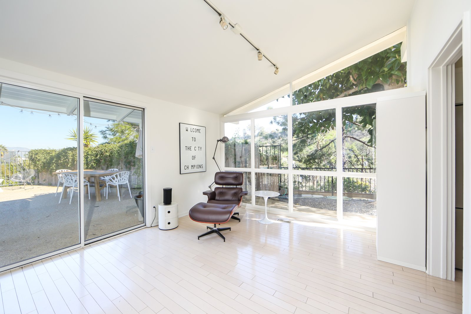 This corner of the open living space looks out to the outdoor living spaces through extensive glass, original skylights, and an angular clerestory design that extends the potential for natural light.  Photo 7 of 10 in If You Crave Bright, Light-Filled Spaces, This Midcentury Home For Sale Could Be the One