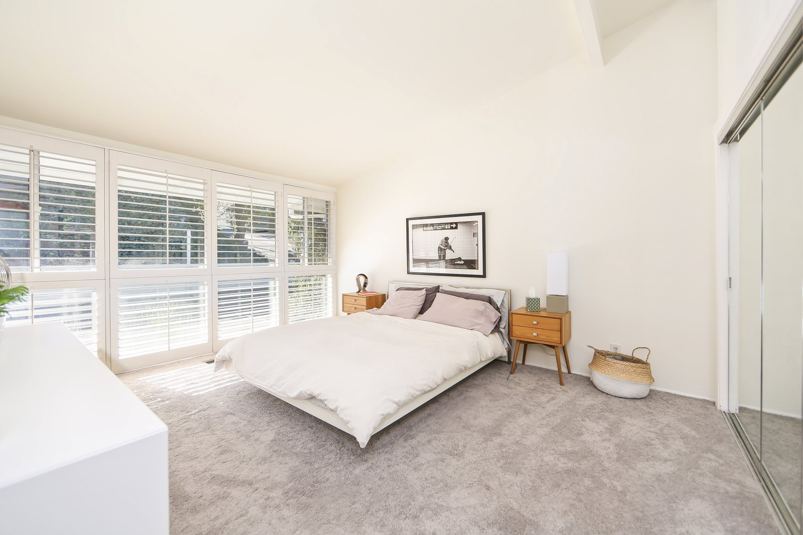 A past renovation included the addition of carpets into the three bedrooms, which have been left clean and simple.  Photo 8 of 10 in If You Crave Bright, Light-Filled Spaces, This Midcentury Home For Sale Could Be the One
