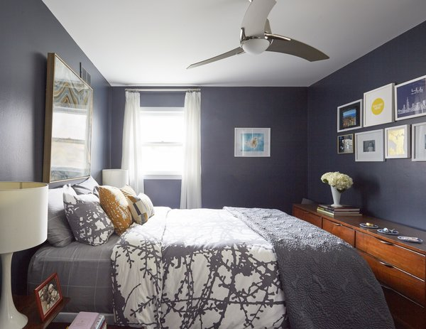Though you cannot see in this photo, they added an extra closet in the bedroom to house Carly's vintage clothing collection. There are two other bedrooms on this upper floor.  Photo 8 of 12 in Clever Storage Solutions and a Shifted Layout Revive This 1950s Chicago Home