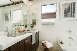The space holds a total of two-and-a-half bathrooms, one of which is ADA-compliant.