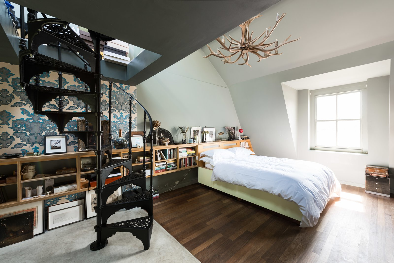 The whole third floor is dedicated to a double-height master bedroom, which contains its own set of original wrought-iron spiral stairs.  Photo 7 of 11 in Formerly Home to an Artist and Knitwear Designer, a Commercial Space-Turned-Dwelling Hits the Market