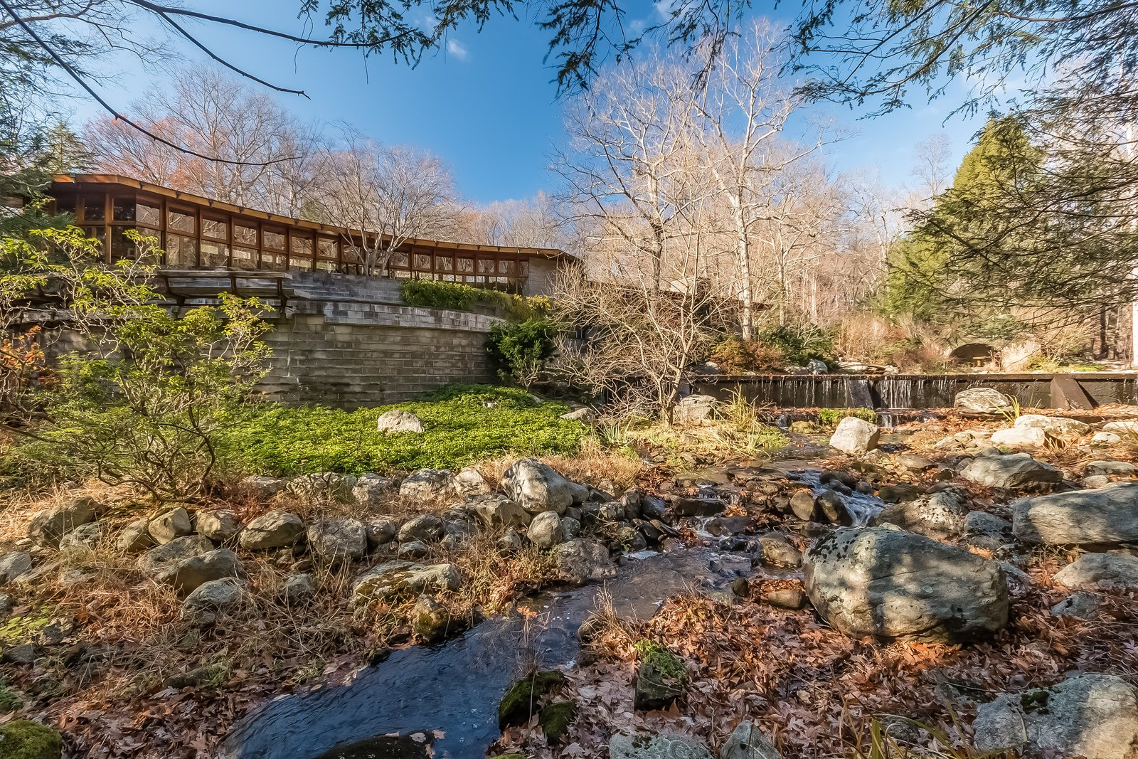 "Similar to his Falling Waters masterpiece, Tirranna was built on water and next to a waterfall. In fact, the word itself comes from an Aboriginal word meaning ""running waters.""  Photo 10 of 11 in Frank Lloyd Wright's Last Major Residential Masterpiece Could Be Yours for $7.2 Million"
