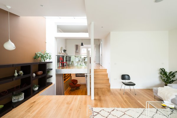 The interesting layout becomes clear from this view, that shows the glass balustrade that separates the dining room from the sitting room. The lower steps lead to a media room on the lower ground floor, which then connects to a guest bedroom with an en-suite bathroom.  Photo 6 of 9 in A Fusion of Old and New Makes this Home For Sale Shine on London's Womersley Road
