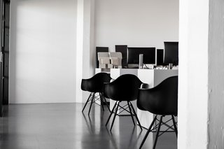 The space is also filled with Herman Miller's all-black edition of the Eames Molded Fiberglass Armchair.