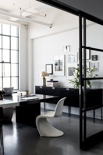 Hollis shares this office with her husband and CEO, Lewis Heathcote. Panton Chairs, designed by Verner Panton for Vitra, can be found in various areas of the office. Poured concrete floors are kept consistent throughout the space.