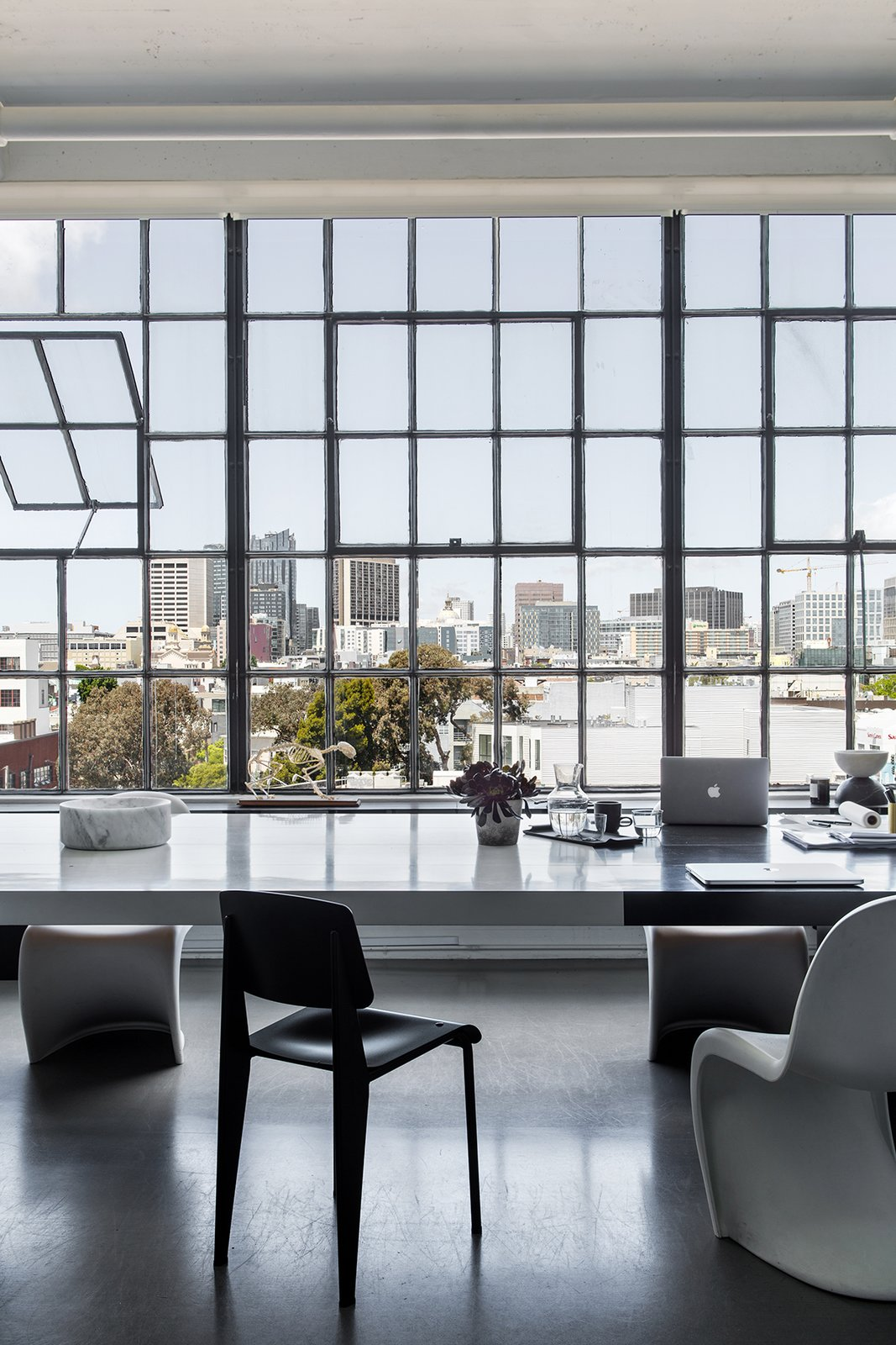 Hollis' team opened the space by removing multiple walls and preserving the original steel windows and high ceilings. The views stretch from the Bay Bridge to Twin Peaks.  Photo 4 of 13 in A San Francisco Design Collective Reveals its Impeccably Cool Creative Studio