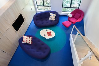 Bright Colors and Sleek White Oak Fill This Playful Lake Tahoe Loft - Photo 8 of 9 - As a rug designer, Simon planned out the large blue dot on the bright blue Tretford carpet. Simon explains that this tough flooring material is made with ribbed goats hair and has recently made a comeback after being a popular wall covering material in the 1970s.
