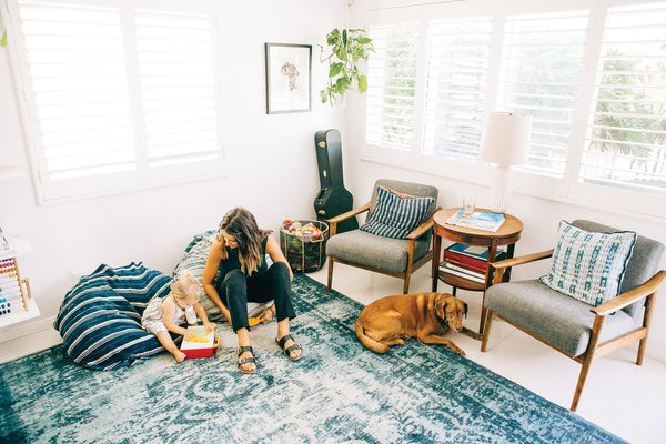 Grant Ellis's wife Julie and daughter Kaia are shown here in their cozy, indigo-filled living room in Cardiff, California.