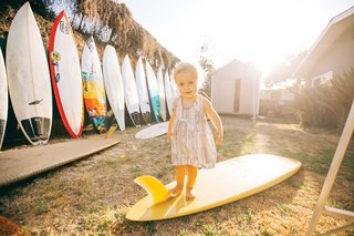 Grant Ellis has been a photo editor at Surfer Magazine for 13 years and lives in a quaint beach shack in Cardiff, California, with his wife Julie, son Ethan, and daughter Kaia (shown here).