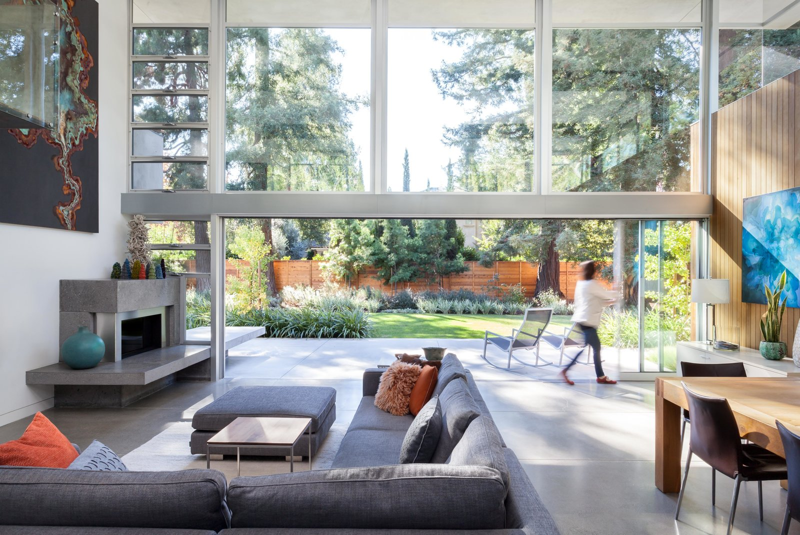 The new great room opens up completely to the patio with multi-panel pocket sliding glass doors that measure seven feet tall and 22 feet long.  Photo 5 of 11 in A Year of Careful Study Leads to a Thoughtful Renovation of a 1949 Eichler