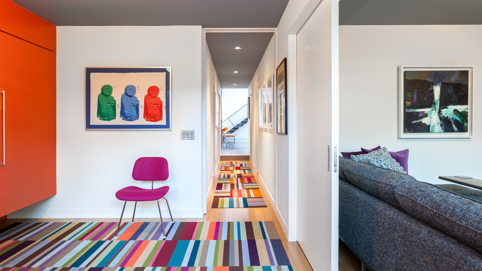 The ground floor  holds the two kids' bedrooms, which were remodeled a bit but kept consistent with the original footprint of the house. A media room sits behind a pocket door, also on the ground level.  Photo 9 of 11 in A Year of Careful Study Leads to a Thoughtful Renovation of a 1949 Eichler