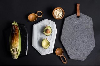 AYRES creates geometric cheese boards made with various tones of marble, lava stone, and leather.