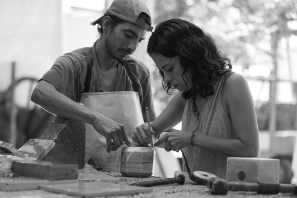 Caterina Moretti, Peca's head designer and studio director, is shown here working closely with a marble object.