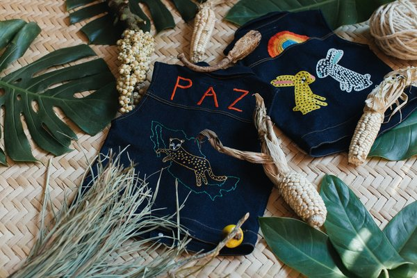 They produce little denim vests for kids that are handmade with a traditional embroidery process in Zinacantán Chiapas, México.  Photo 9 of 18 in Part II of Our Exploration of Mexico City's Caravana Americana