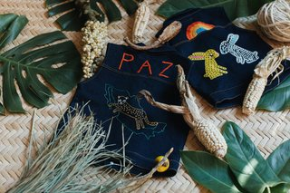 They produce little denim vests for kids that are handmade with a traditional embroidery process in Zinacantán in Chiapas, México.