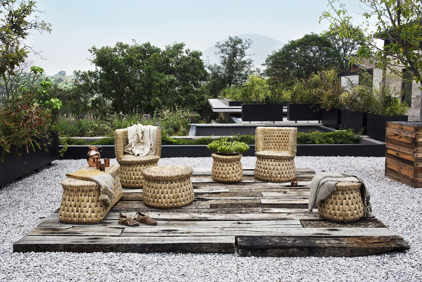 "txt.ture's first collection is made in alliance with master artisan Don Nacho Morales, and includes six furniture pieces that are inspired by functional seating pieces used throughout Aztec history. Shown here is the tabouret, individual armchair, and wooden core bench—all made with locally-sourced seagrass, or ""tyle.  Photo 3 of 16 in Caravana Americana Showcases the Passion of Latin America's Design Community"