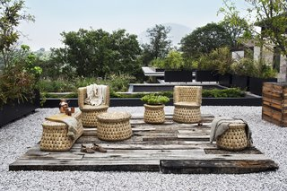 "txt.ture's first collection was made in alliance with master artisan Don Nacho Morales, and includes six designs that are inspired by functional seating pieces that were used in daily life by the Aztecs. Shown here is the tabouret, individual armchair, and wooden core bench—all made with locally-sourced seagrass, or ""tyle."""