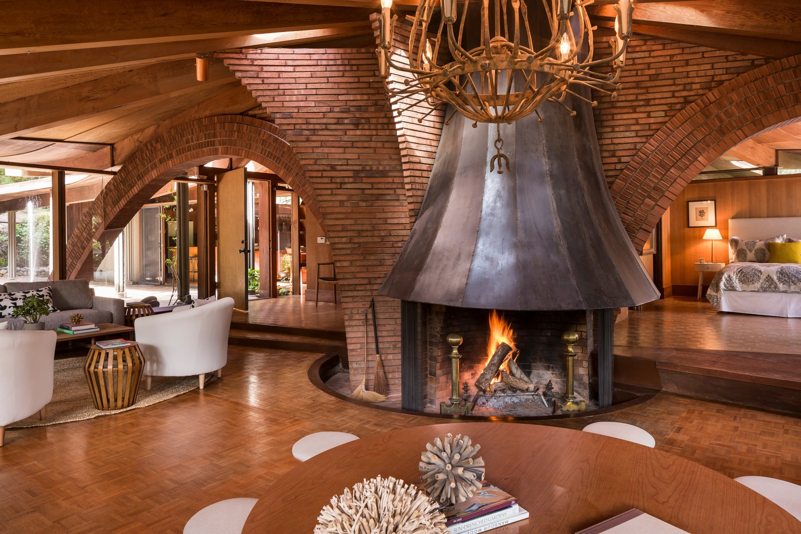 Liebermann had the steel fireplace fabricated off-site, which acts as the center of the house. Jay Little told us that he worked with many local businesses to get the work done on the house, some of which are still around.  Photo 5 of 17 in The Midcentury Home That Daniel Liebermann Built For His Parents Asks $2.8 Million