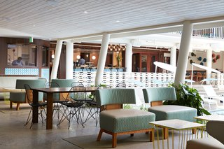 When you make your way from reception to the elevator, this covered patio space is filled with midcentury-inspired furniture and offers fruit-infused ice water to enjoy on your way to your room. The original details of the midcentury structure are clearly highlighted in this space where many guests can be seen catching up on their emails with a complimentary coffee in-hand.