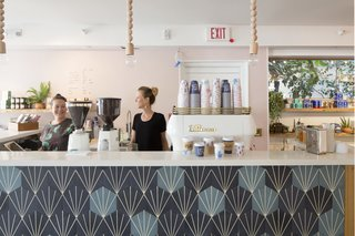 This Surf-Inspired Hotel Celebrates Waikiki's Creative Spirit and its Midcentury Roots - Photo 9 of 13 - Olive & Oliver catches your eye on the left as soon as you enter the property. Founded by husband-and-wife team, Ali McMahon and Parker Moosman, the coffee shop is accompanied by a boutique that boasts a curated collection of fashion and home goods that are inspired by iconic surf culture.