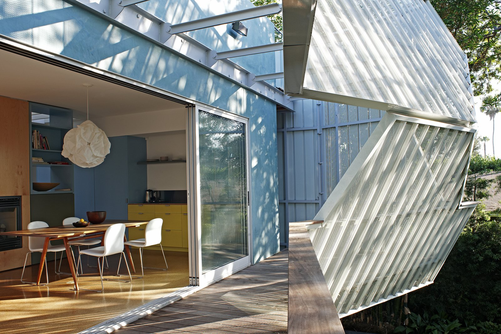 Outdoor, Small Patio, Porch, Deck, and Wood Patio, Porch, Deck  Photo 5 of 10 in A Perforated Screen Brings Privacy and Natural Light to This Bold Venice Home
