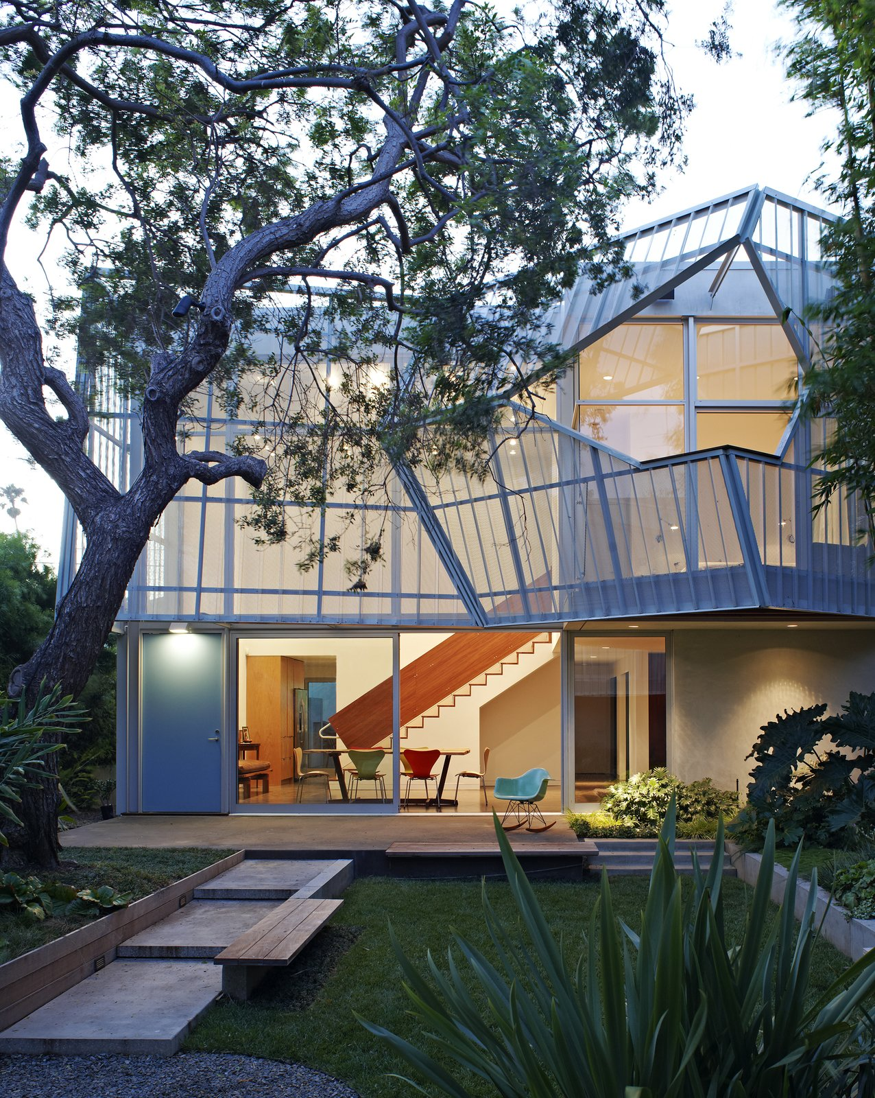Outdoor, Grass, Small Patio, Porch, Deck, Concrete Patio, Porch, Deck, and Back Yard  House ideas from A Perforated Screen Brings Privacy and Natural Light to This Bold Venice Home
